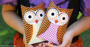 Free printable owl halloween treat boxes, favor bags, Orange, purple and green. Witch holding 2 owl pillow boxes by Press Print Party!