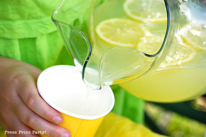 pouring lemonade in glass Press Print Party