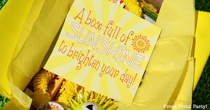 card in open box. A box full of sunshine to brighten your day.