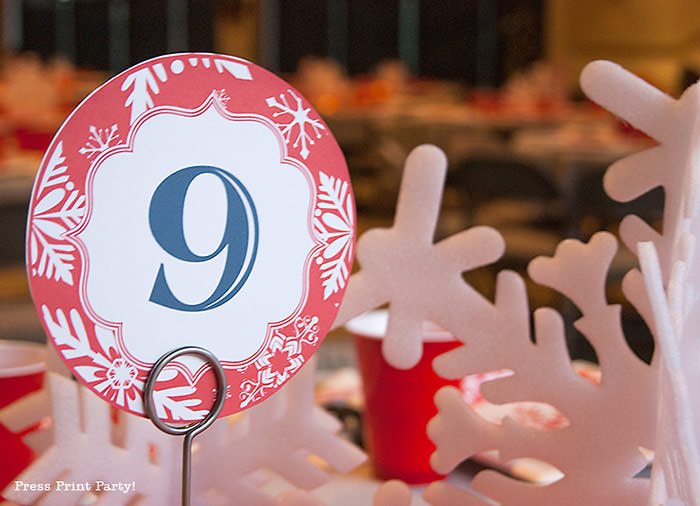 DIY Christmas Centerpiece Ideas red snowflake red and white table number. White foam snowflakes on table. table number 9 - Press Print Party!