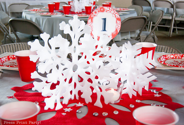 DIY Christmas Centerpiece Ideas red snowflake red and white christmas paper plates with red cup. grey tablecloth. big red felt snowflake - Press Print Party!