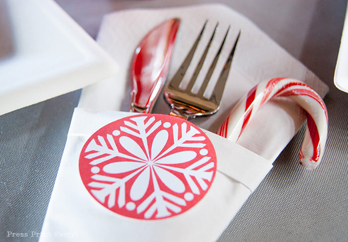 DIY Christmas Centerpiece Ideas red snowflake fork and knife and candy cane in white napkin Press Print Party!