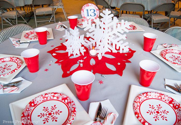 DIY Christmas Centerpiece Ideas red snowflake white foam snowflake on red felt snowflake table number 1 press Print Party!