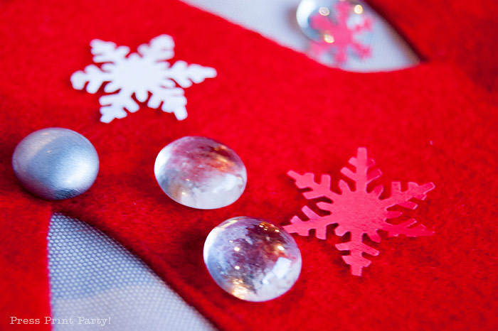 DIY Christmas Centerpiece Ideas red snowflake white foam snowflake on red felt snowflake. snowflake punch Press Print Party!