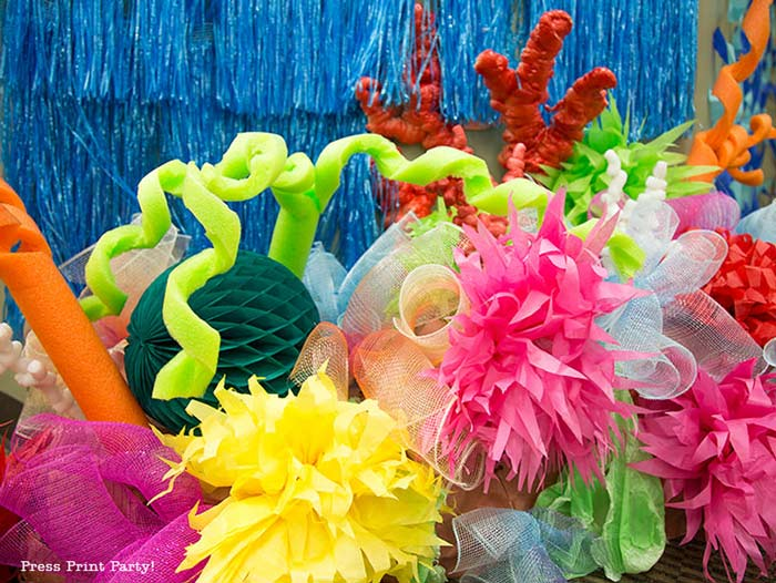 faux coral reef with pool noodles, paper flowers, spray foam coral etc... Press Print Party!