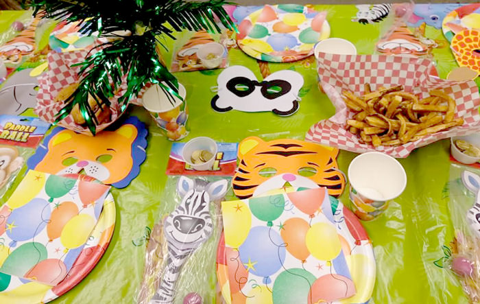 Jungle party tablescape with animal masks