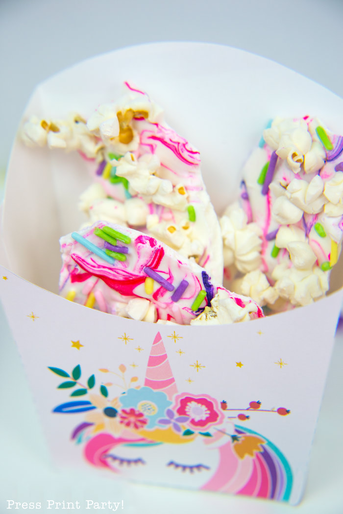 unicorn favor boxes with white chocolate bark inside