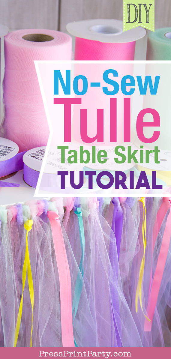 Tulle table skirt with rolls of tulle and ribbons with text