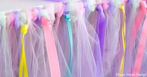 Tulle table skirt with rolls of tulle and ribbons