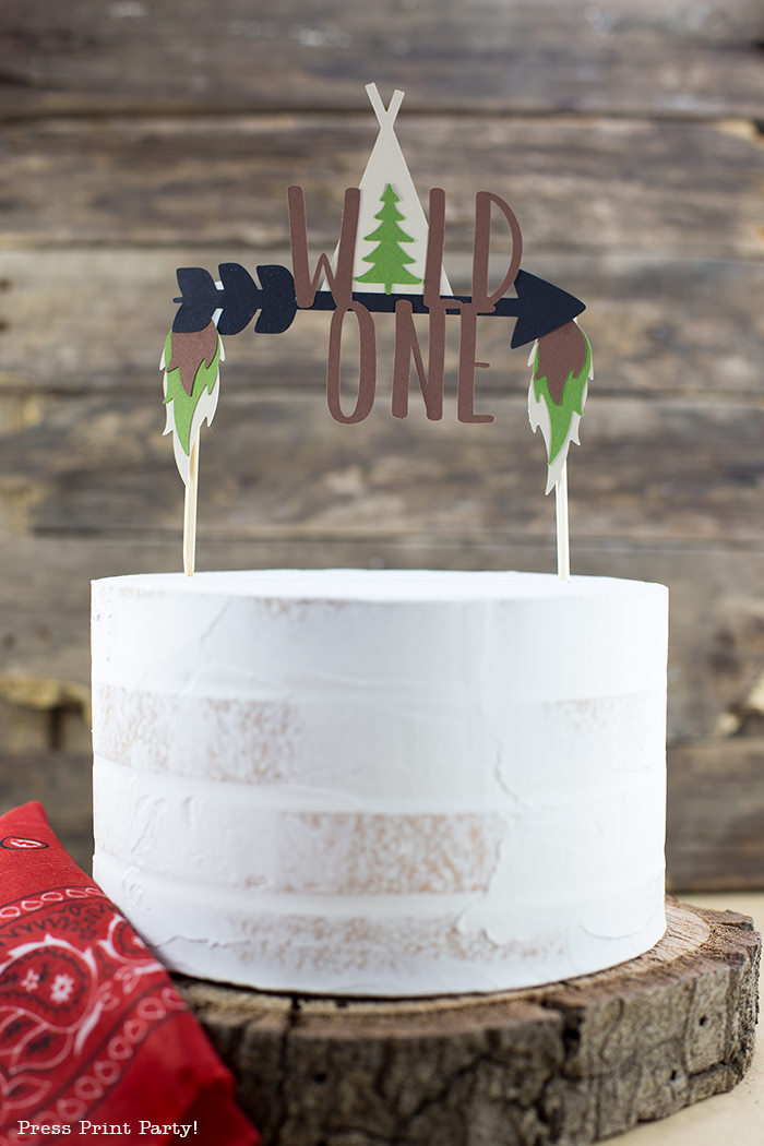 Cake with a Wild One cake topper with arrow and tipi.
