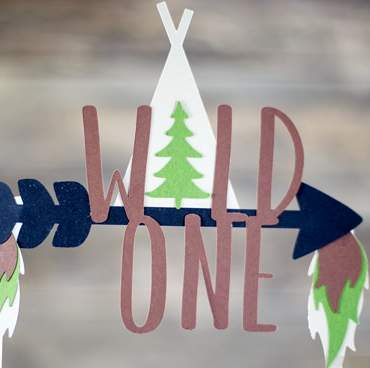 Wild one cake topper make of cut paper