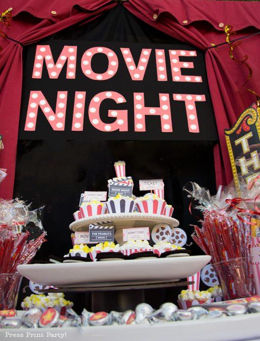 Movie night marquee. Backyard movie night dessert table.Backyard movie night party ideas - Movie night cupcakes with popcorn - Printables by Press Print Party!