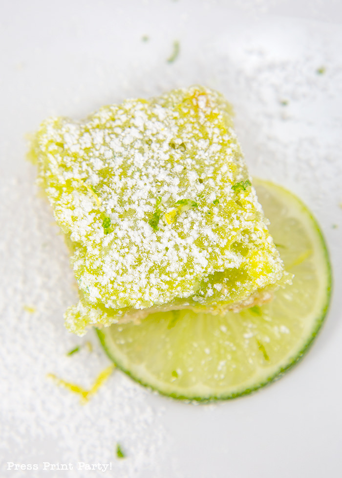one square of lime bar with lime wedge