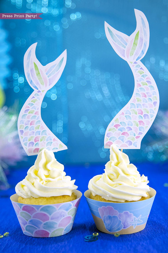 Mermaid cupcakes with scales wrapper and long mermaid tail topper. Printables by Press Print Party!