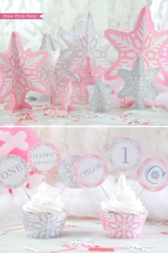 Winder ONEderland Printable birthday party table decorations snowflakes and cupcake toppers and wrappers in pink and silver snowflakes - Press Print Party!