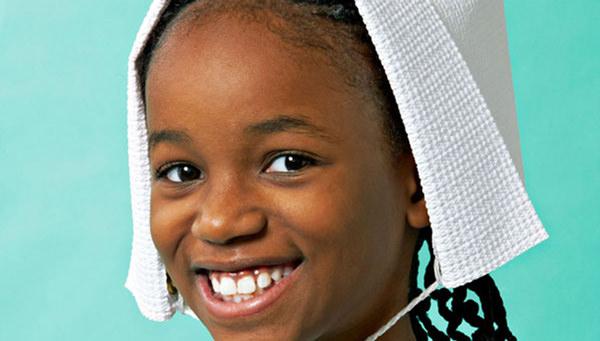 girl with pilgrim bonnet. free pilgrim hat template