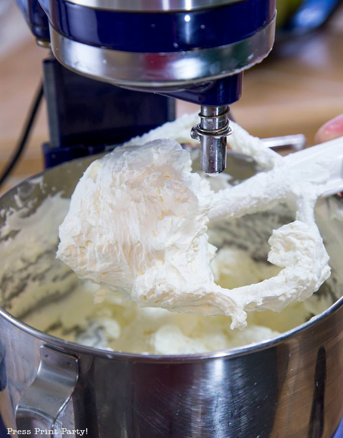Whisk with white Swiss meringue buttercream frosting - Press Print Party!