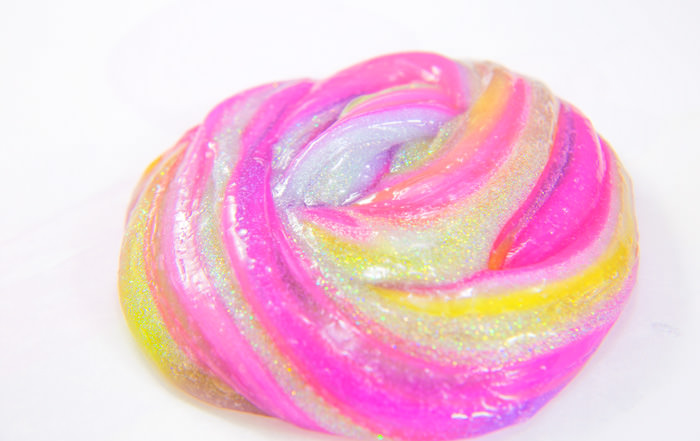 Foolproof slime recipe, striped slime with clear and glitter slime made with glue and contact solution.