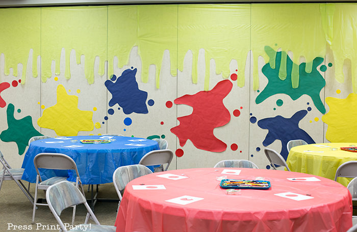 slime walls with paper and plastic tablecloth backdrop -Science party decoration ideas DIY -Press Print Party!