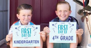 FREE First day of school signs printable - Back to school photo ideas - picture of 2 boys. First day of kindergarten and first day of 4th grade.by Press Print Party!