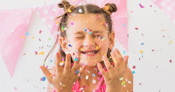 girls throwing confetti