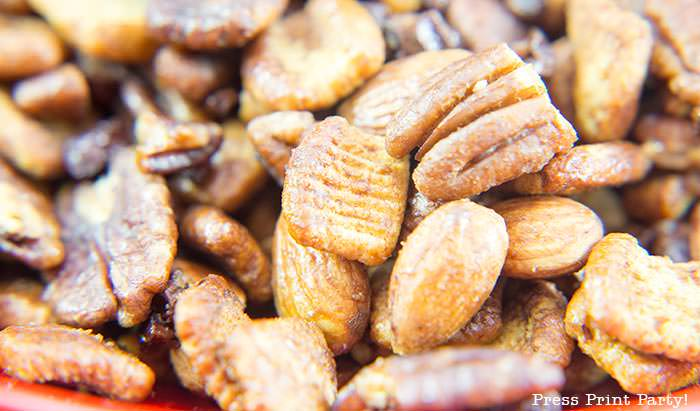 crunchy keto trail mix recipe with catalina crunch cereal, almonds, cocoa nibs, serve, and pecans.