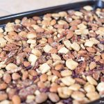 before oven. crunchy keto trail mix recipe with catalina crunch cereal, almonds, cocoa nibs, serve, and pecans.