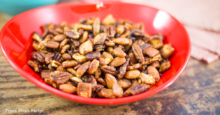 crunchy keto trail mix recipe with catalina crunch cereal, almonds, cocoa nibs, serve, and pecans. In a red bowl