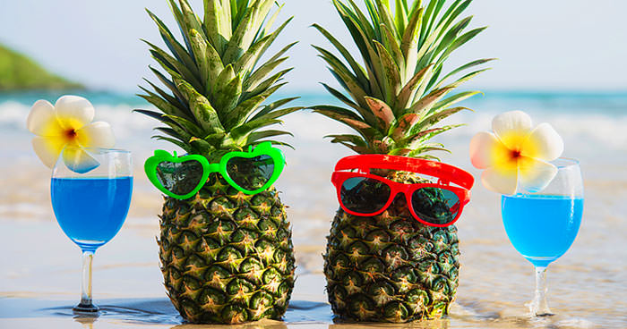 party on a budget food ideas 2 pineapple on the beach with a drink