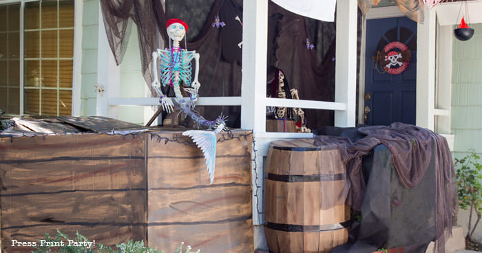 diy pirate ship- haunted pirate ship- Halloween porch decor ideas - Halloween Front porch ideas - Halloween porch decor - pirate decorations - Pirate skeleton - Mermaid skeleton - Press Print Party!