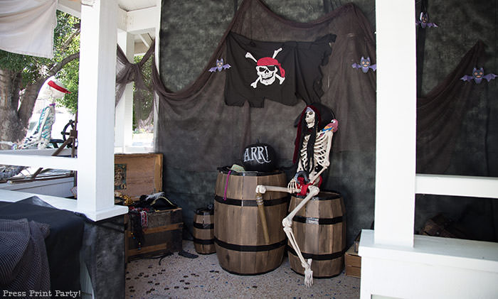 Pirate skeleton with pirate hat and parrot on his shoulder. with a chalkboard pumpkin. Halloween front porch decor ideas - Press Print Party!
