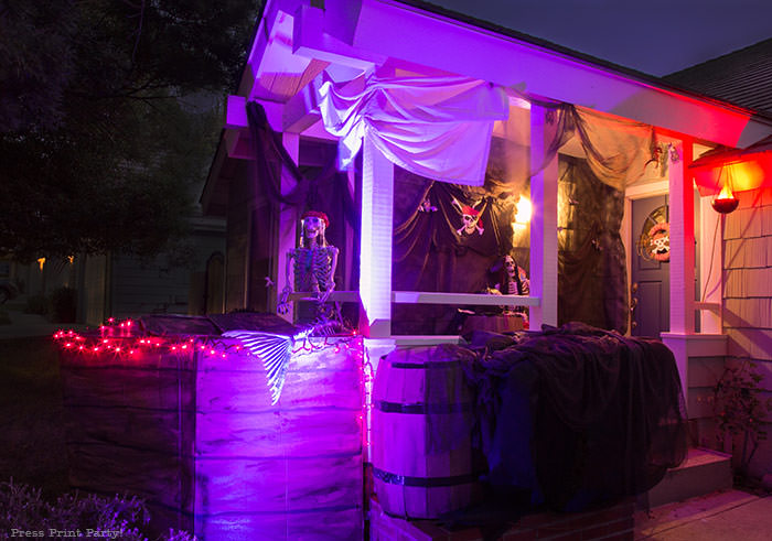 diy pirate ship at night- lighted haunted pirate ship- Halloween porch decor ideas - Halloween Front porch ideas - Halloween porch decor - pirate decorations - Pirate skeleton - Mermaid skeleton - Press Print Party!