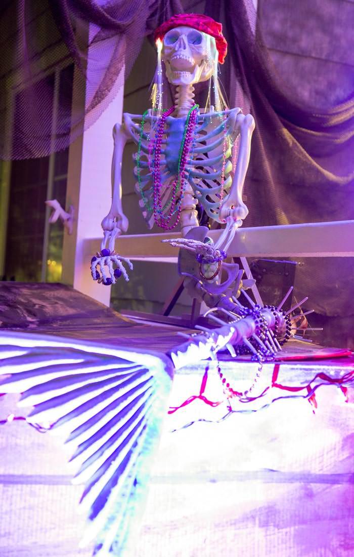 skeleton mermaid on DIY pirate ship made out of cardboard. night lighting LED purple lightPress Print Party!