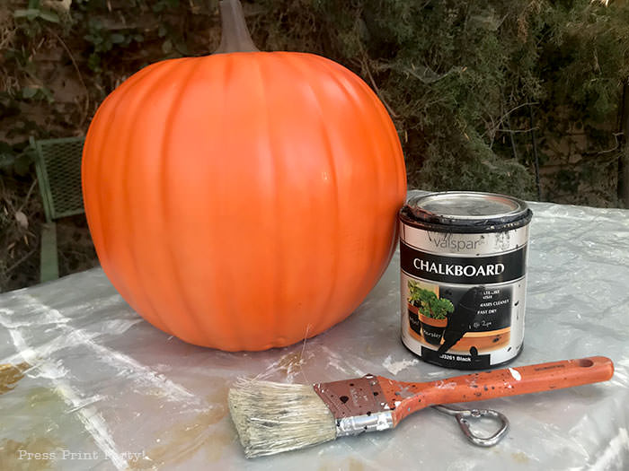 Painting an orange foam pumpkin with black chalkboard paint. and how to do the chalk lettering - Press Print Party!