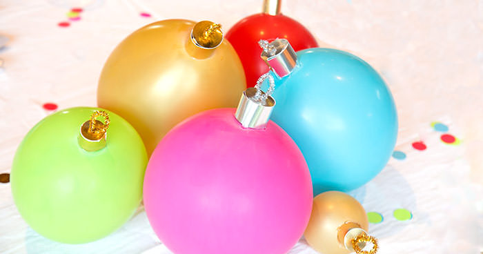 close up of balloon ornament for Christmas table centerpiece. Balloons with ornament toppers in green, gold, blue, red and hot pink. Press Print Party!