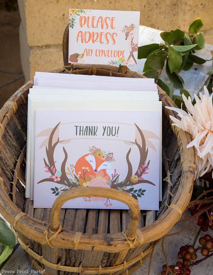 Woodland baby shower thank you note with cute fox and antlers and flowers. in a basket with a note on a place card. Woodland animals Baby Shower Theme with woodland creatures and forest animals party supplies. Woodland decoration girl baby shower ideas. Can be used for woodland birthday party. Rustic forest animals with flowers and antlers. Fox baby shower, Deer baby shower.