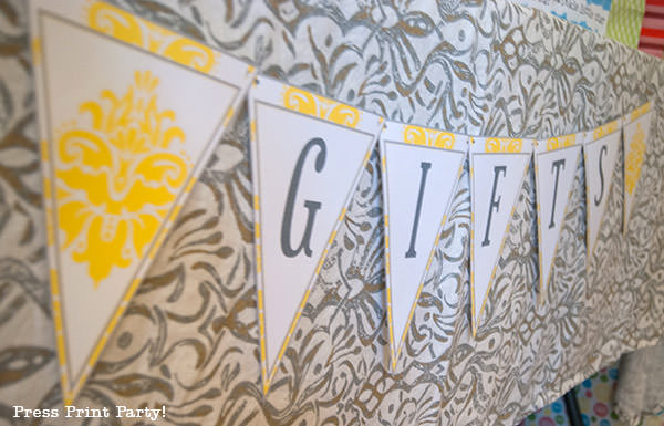 yellow and grey banner for gifts at part table.