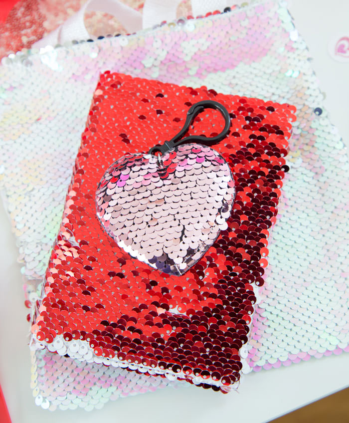 Flip sequins bag with flip sequins notebook and flip sequins heart clip keychain as party favor ideas - Galentine's Day Party Ideas for Teens - Press Print Party!