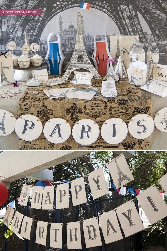 Paris Party desert table with paris party printables. Eiffel tower backdrop and centerpiece with cupcakes and french flag. Vintage French Party decorations and treats. With Paris banner and red whit and blue balloons. Press Print Party!