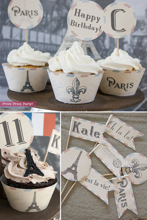 Paris party printables. cupcake wrappers with Eiffel tower and fleur de lis. Cupcake toppers with Eiffel tower topper. Press Print Party!