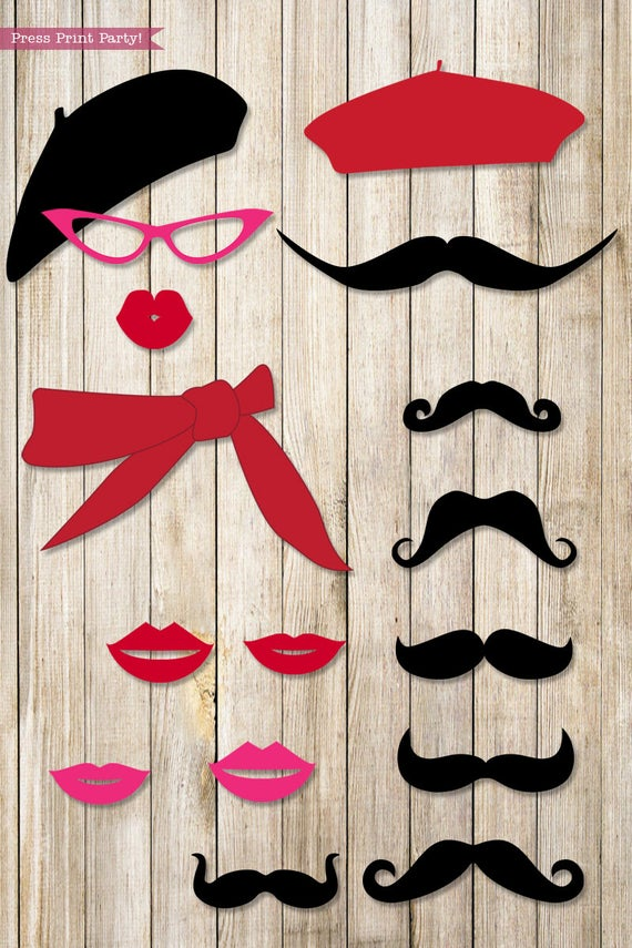Paris photo booth props. mustaches, lips, glasses and berets. Press Print Party.