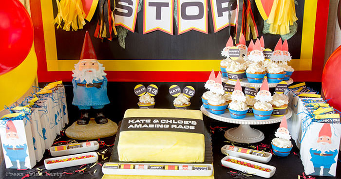 The amazing race party ideas - birthday party table with cake and tavelocity gnomes. Press Print Party!