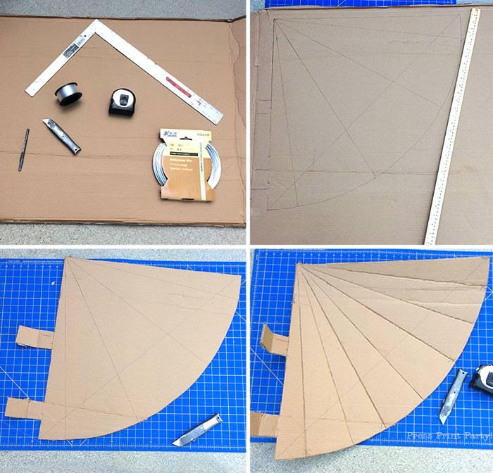 making the gnome pinata cutting the cardboard