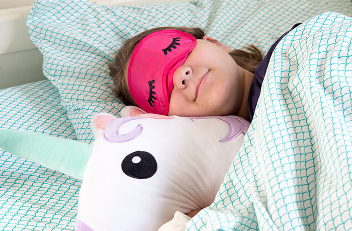 sleeping girl with sleep mask with eyelashes and unicorn pillow. Press Print Party!