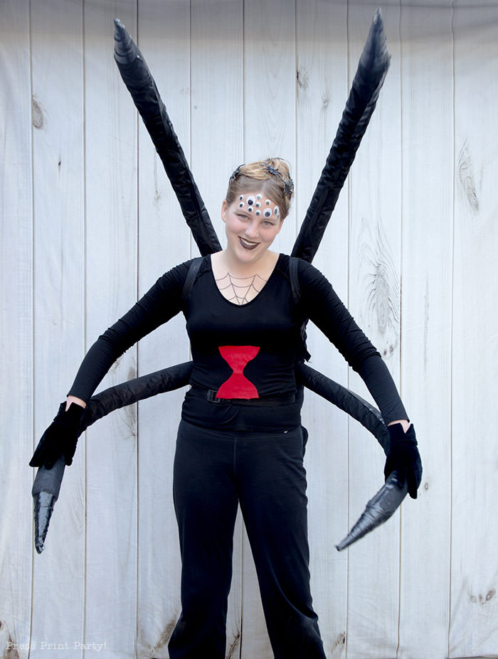Spectacular Black Widow costume DIY - Girl standing looking like a spider.How to make a spider costume at home - Press Print Party