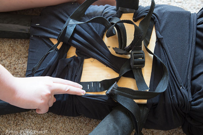 backpack straps being stapled to the inside