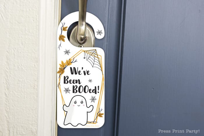 You've been booed sign and We've been booed sign halloween game with instructions Press Print Party! front door hanger