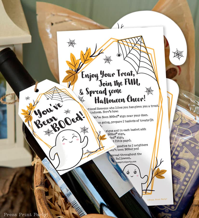 You've been booed sign and We've been booed sign halloween game with instructions Press Print Party! wine bottle in basket at front door