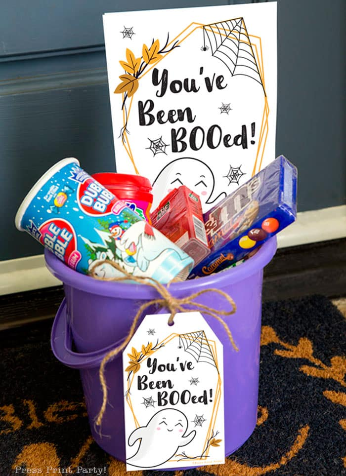 You've been booed sign and We've been booed sign halloween game with instructions Press Print Party! basket of treats at front door in bucket.