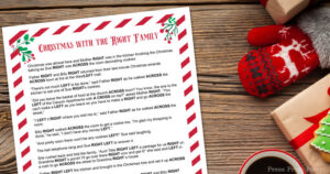 The left right game christmas story printed on paper on a wood table
